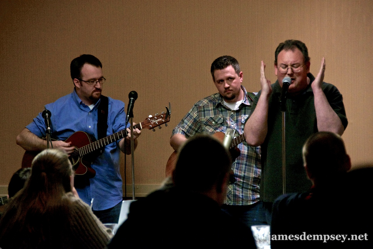 Brandon Alexander and Ben Scheirman playing guitar with James Dempsey singing