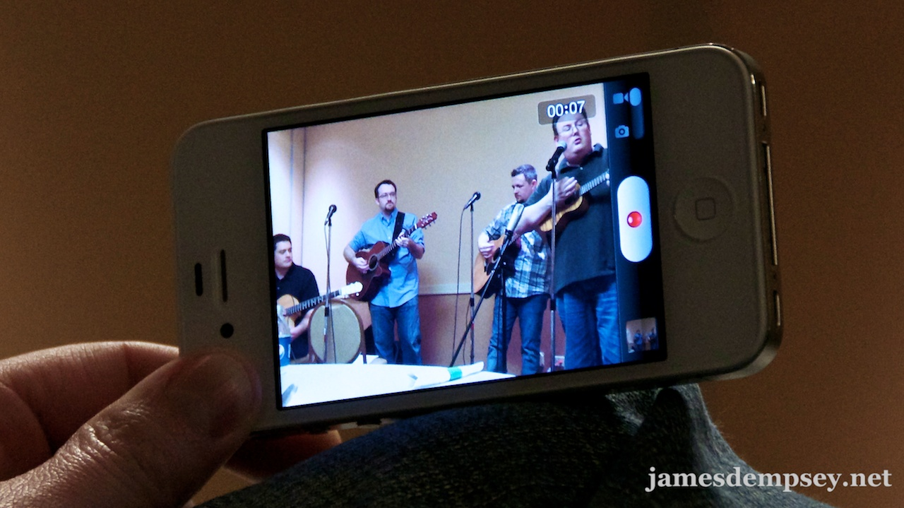 A video of the band being recorded on an iPhone screen