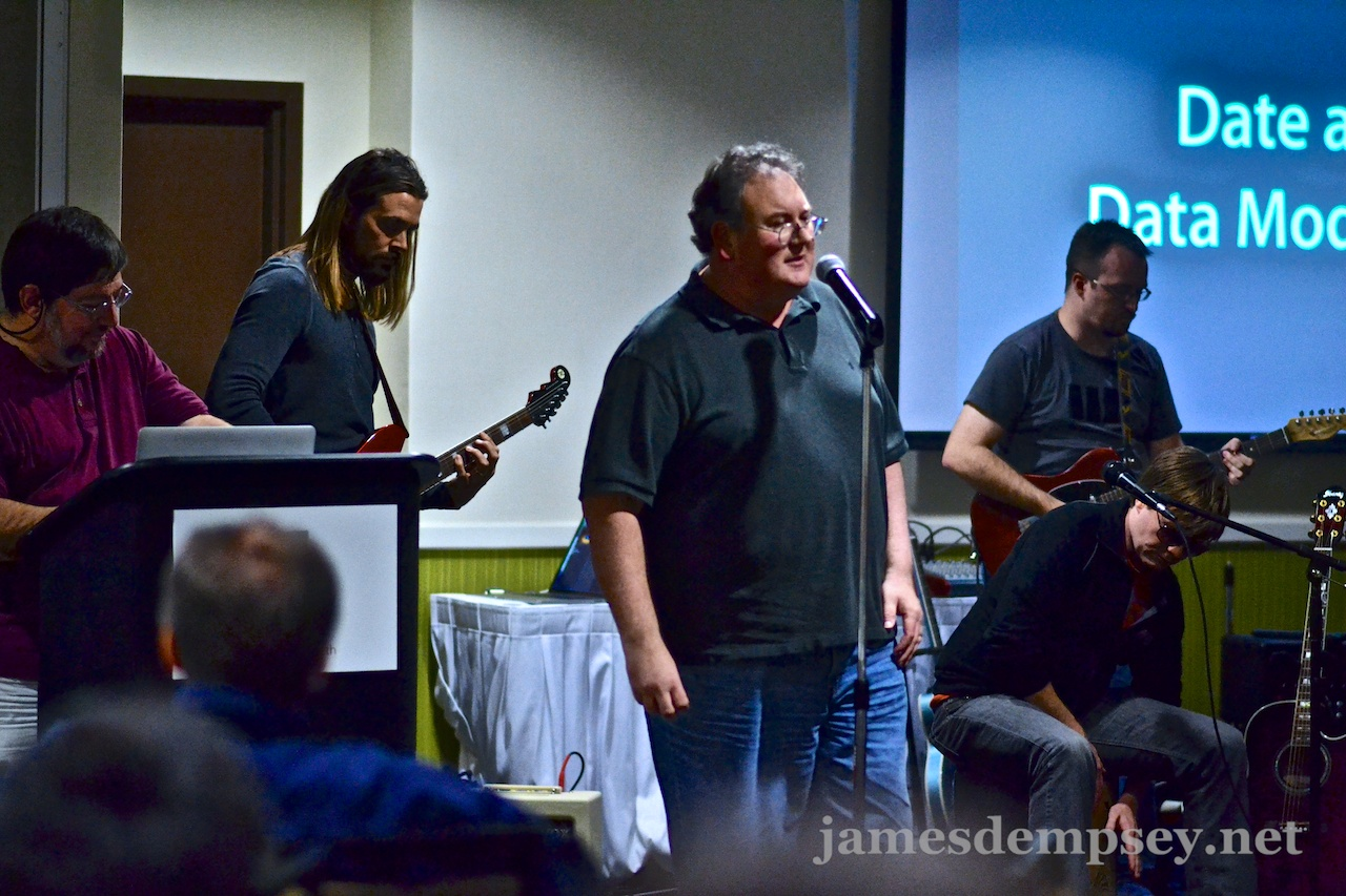 James Dempsey sings Modelin' Man while backed by Daniel Steinberg, Rusty Zarse and Brandon Alexander