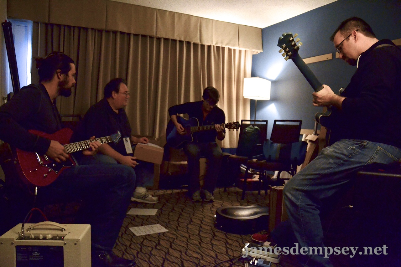 Rusty Zarse, James Dempsey, Jonathan Penn and Brandon Alexander rehearse while sitting in a circle in a small room