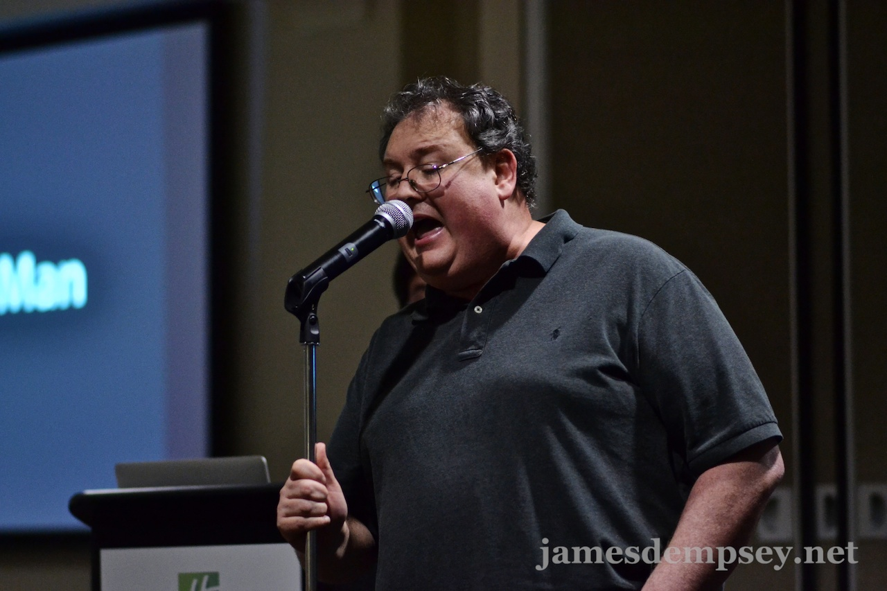 James Dempsey singing into microphone
